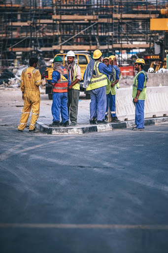 Photo of 7 male construction workers in PPE