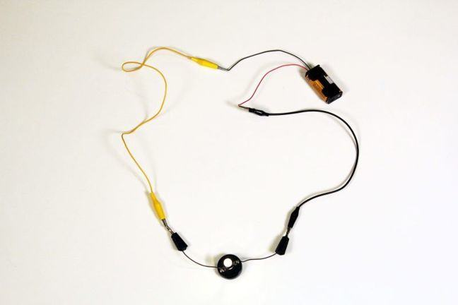 Simple circuit with a bulb and battery, the bulb is lit