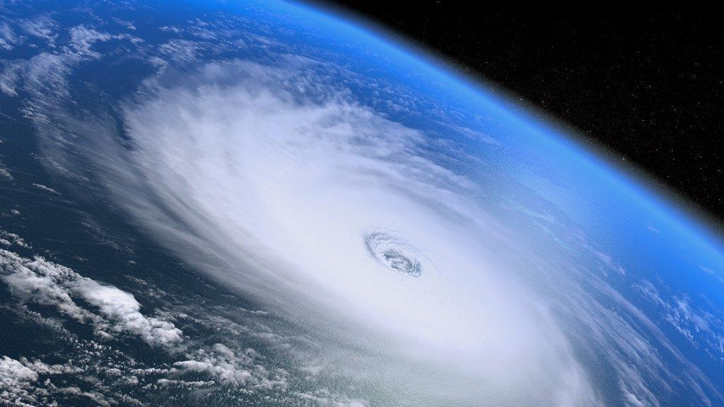 Photograph from space of a hurricane with swirling cloud and a clear eye