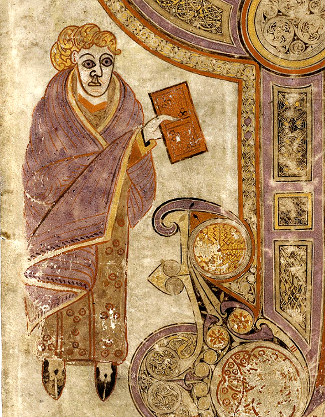 folio 29r from the Book of Kells, a man holding a book