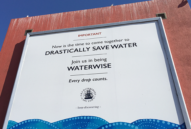 "Billboard in Cape Town with the text ""Now it is time to come together to drastically save water - Join us in being waterwise - Every drop counts"""