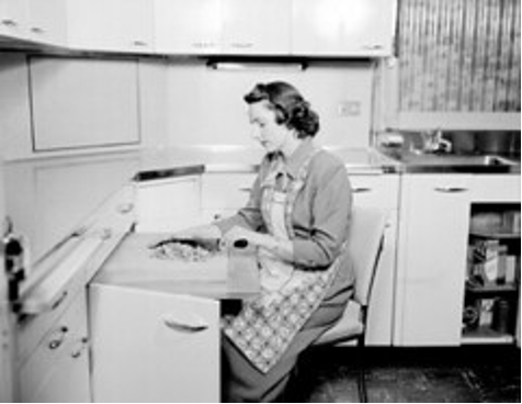"""Home economist chopping nuts, 1950"""