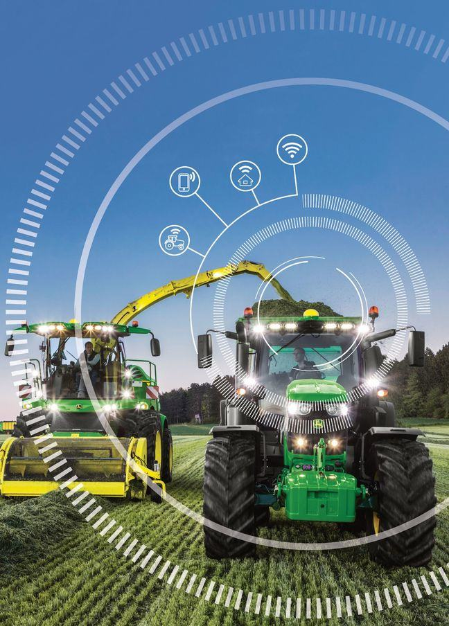 Two tractors surrounded by illustrations of wireless technology