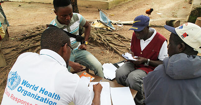 A meeting with members of the ebola response team of the World Health Organization and local community members