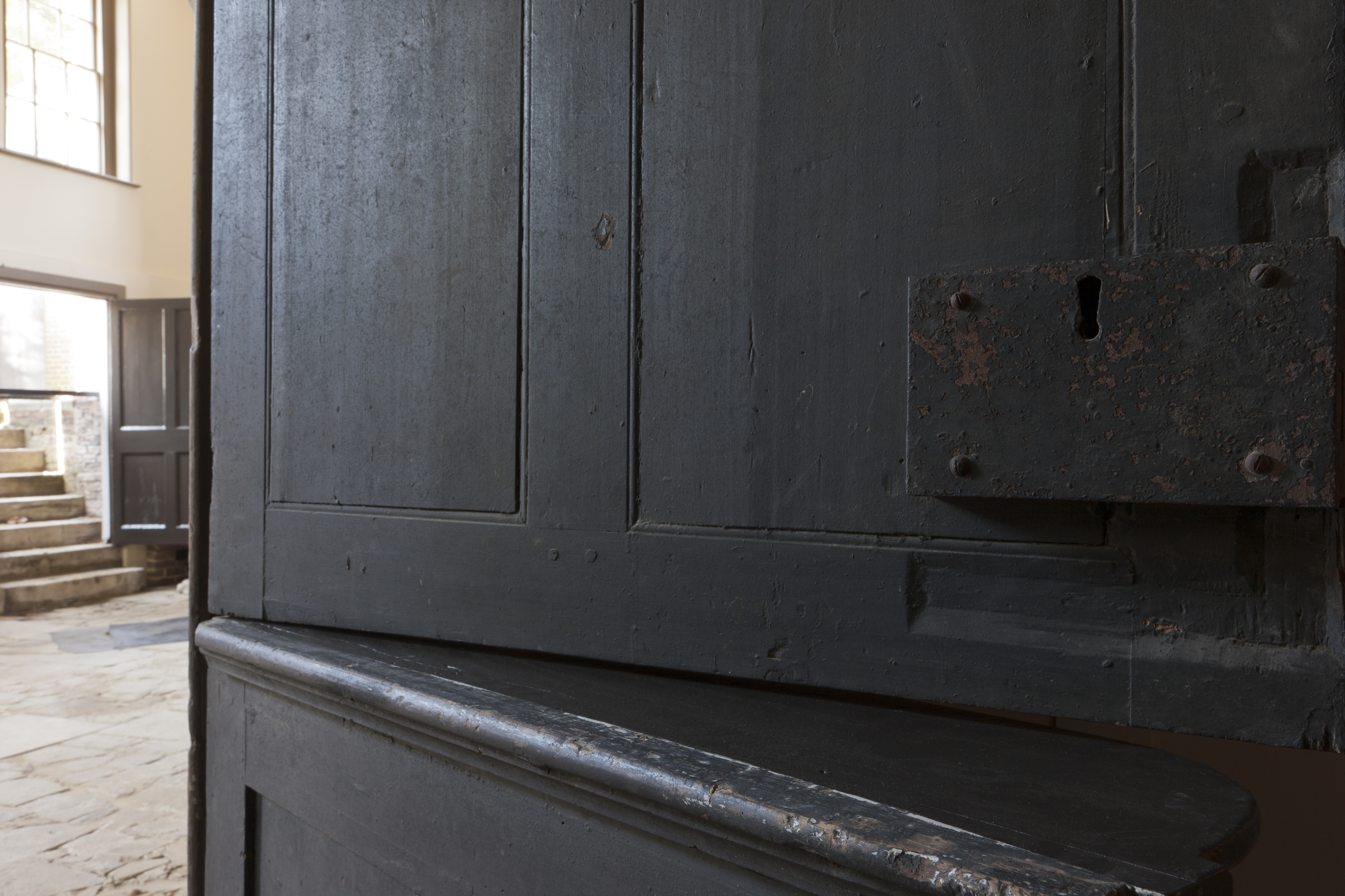 A photo of a black kitchen door showing a ledge