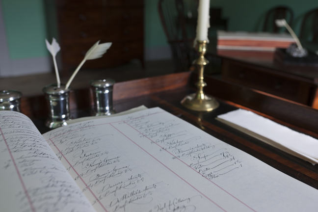 A close up photograph of a written ledger