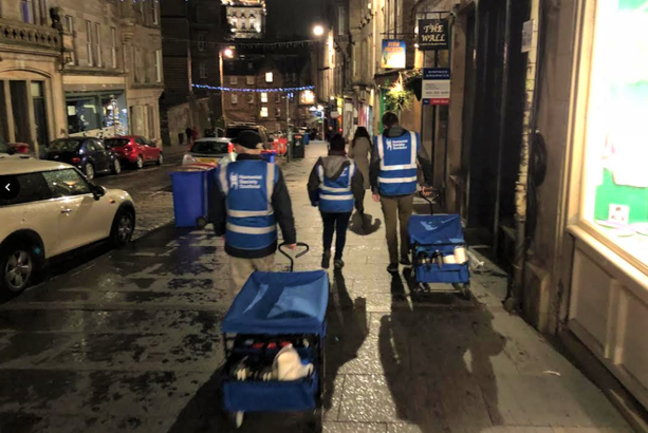 Humanist Society Scotland volunteers on a walk to deliver food and clothing to rough sleepers