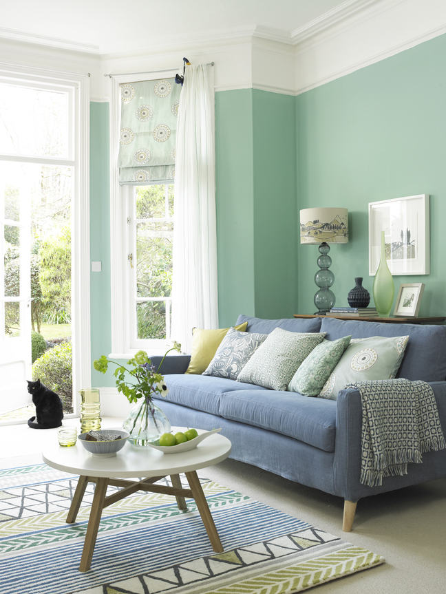 A magazine image of a sitting room decorated in blue and green