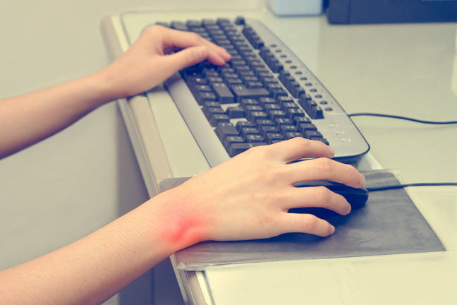 Two hands and a keyboard. Wrist pain in the right hand _COLOURBOX11400919.jpg