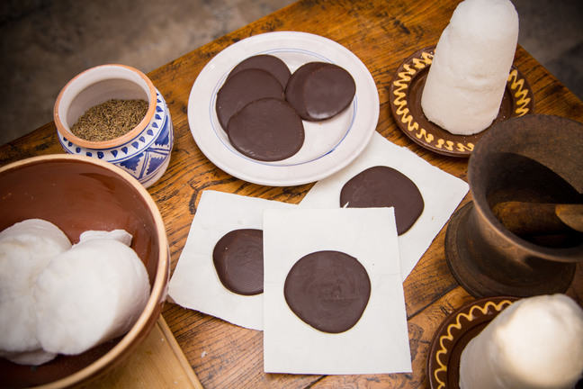 A photo of a chocolate cakes on a wooden table