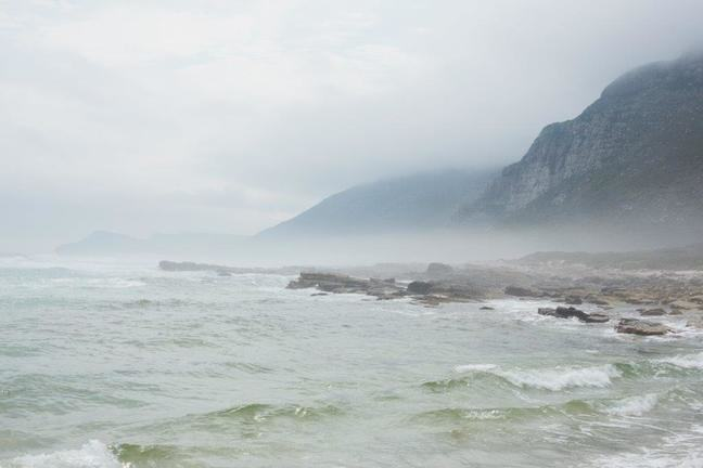 Photograph of sea fog at the bottom of coastal cliffs