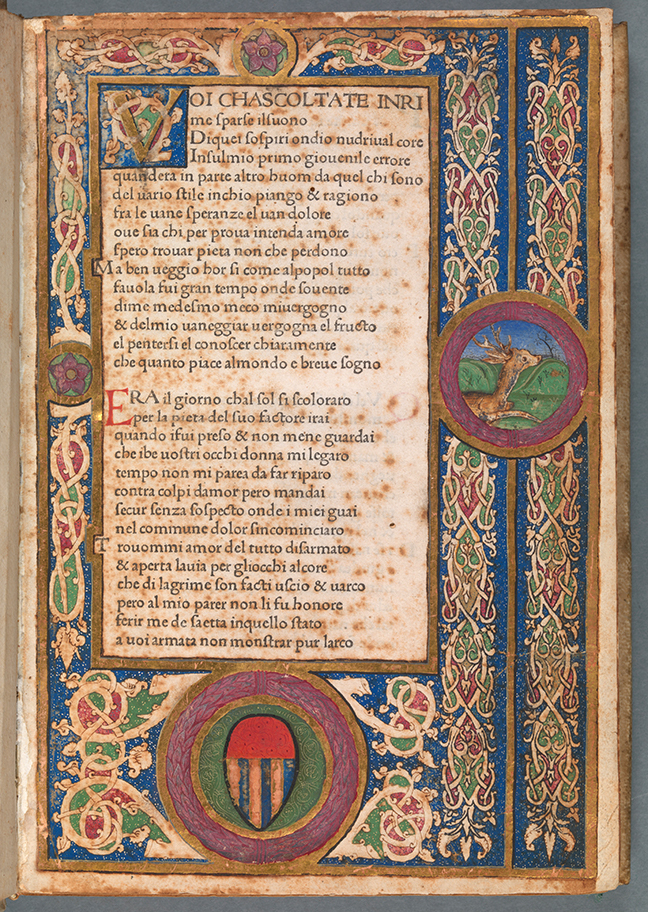Woodcut templates on the first folio of Petrarch with coloured detail around the side of the page and text in the middle, *Canzoniere* (Vindelinus de Spira, 1470), fol. 1r. © The Board of Trinity College Dublin.