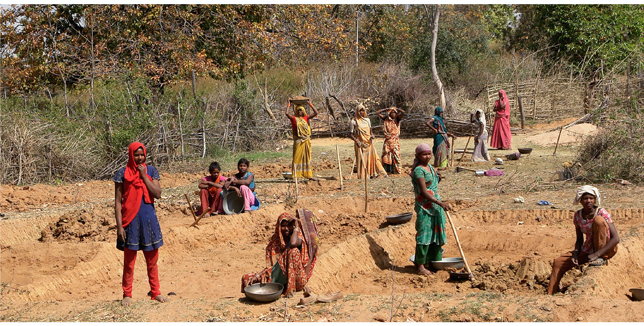 Women working on a road in India