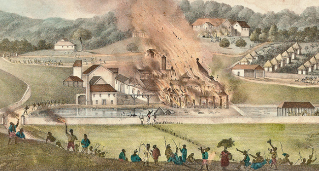 Depicts a set of buildings on a plantation on fire while enslaved people watch in the foreground