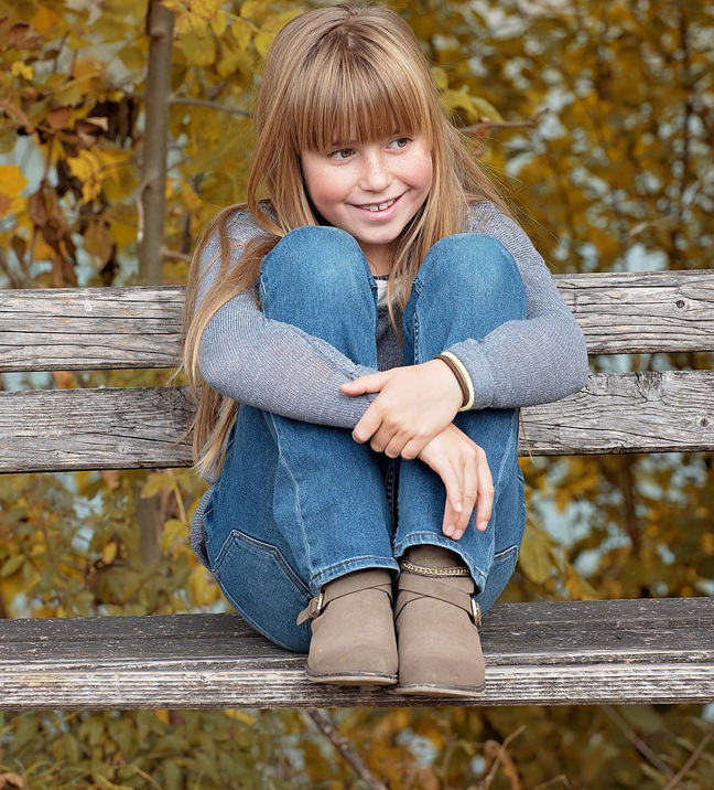 A girl sitting on a bench