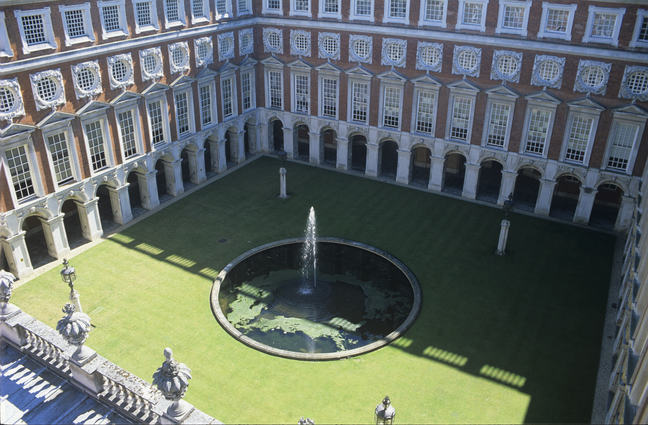 An aerial photograph of the Fountain Court, which has a round fountain in the middle of a square green lawn