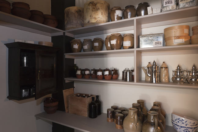 A photograph of shelves filled with pots and jugs