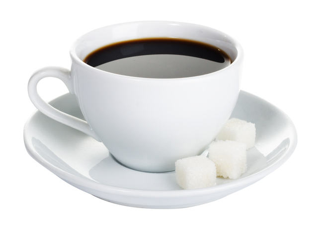 A cup of coffee and three cubes of sugar