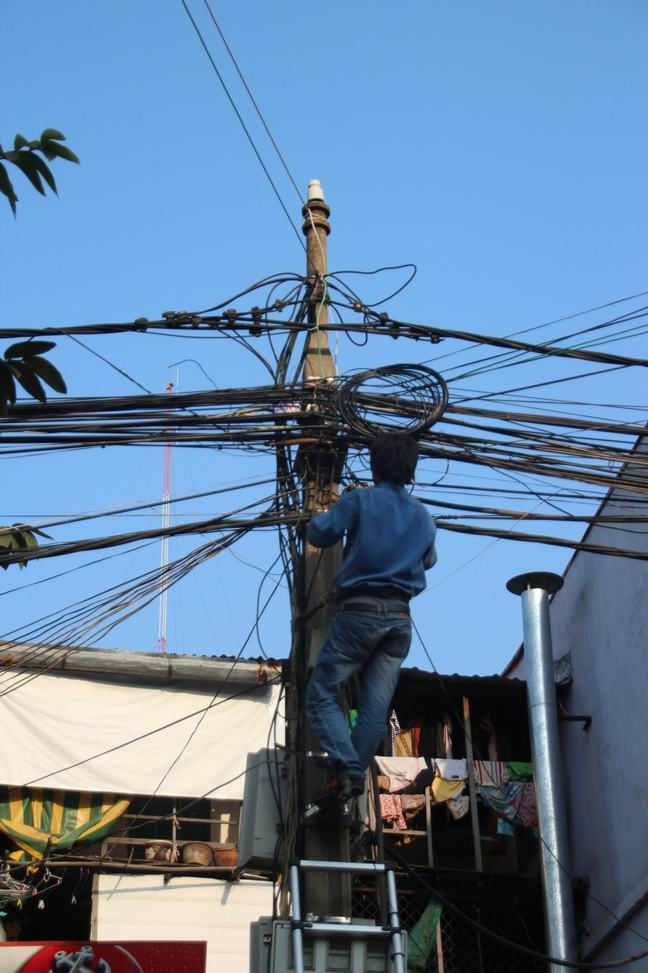 A worker working close to high-current lines being exposed to several risk