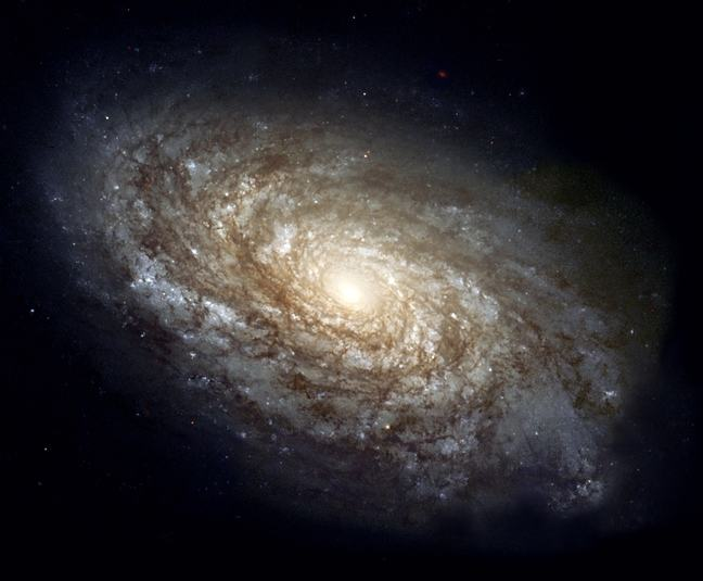 The dusty spiral galaxy NGC 4414 in full colour imaged by the Hubble Space Telescope