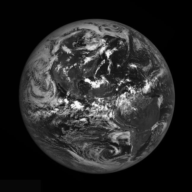 A black and white satellite image showing the Earth from space