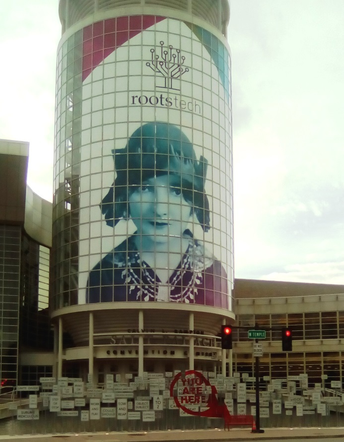 View of convention centre in Salt Lake City with RootsTech poster