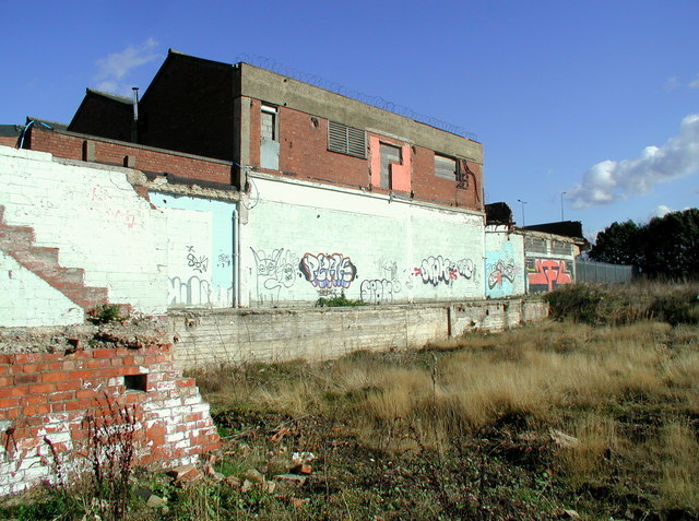 A photograph showing the land next to a building, Hull. The land looks underused and vacant