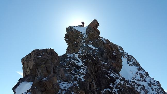 A climber on top of a high mountain