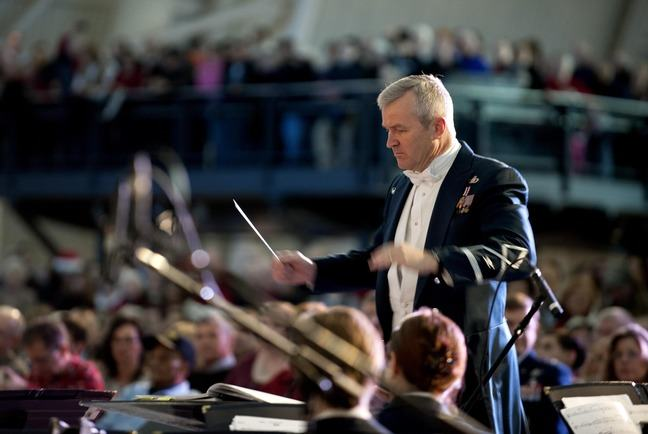 A photo of a music conductor