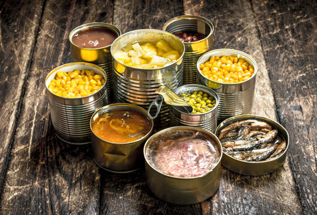 selection of tins opened and showing contents of sweetcorn, beans, pineapple and fish