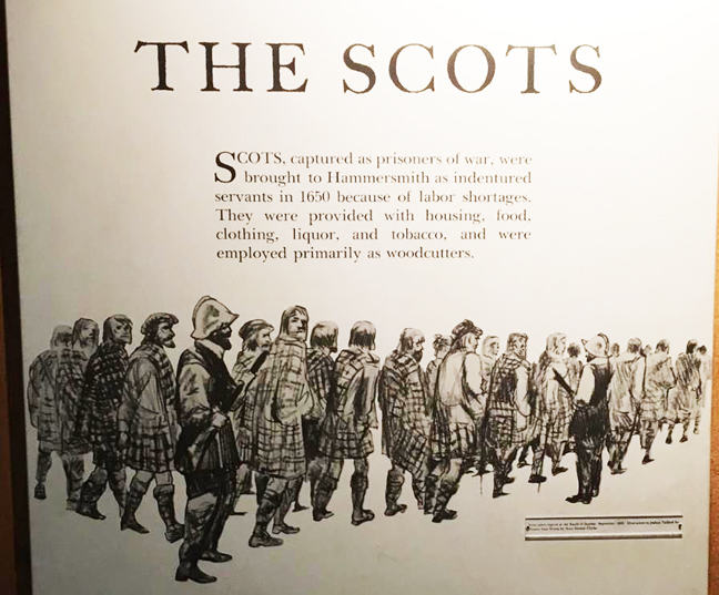 Detail of the panel from the Scots exhibit. The text reads: 'The Scots. Scots, captured as prisoners of war, were brought to Hammersmith as indentured servants in 1650 because of labor shortages. They were provided with housing, food, clothing, liquor, and tobacco, and were employed primarily as woodcutters.