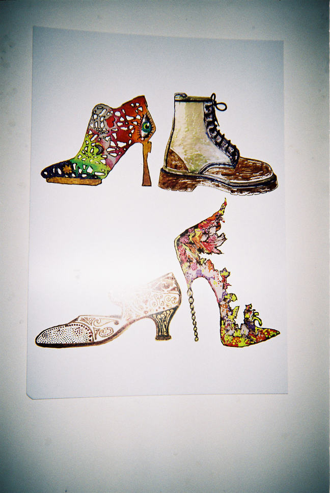 This photograph shows a painting on white paper. The painting depicts four very different shoes, ranging from highly decorative, ornate and colourful high heels, to heavy duty steel toe cap boots.
