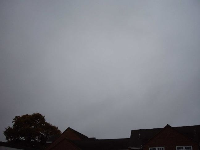 Very faint wispy white clouds against a grey sky