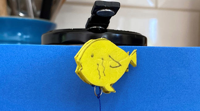 Magnetic fish 'floating' underneath a magnet, with wire attached below to prevent it meeting the magnet