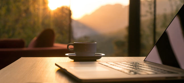 Coffee in front of a sunset
