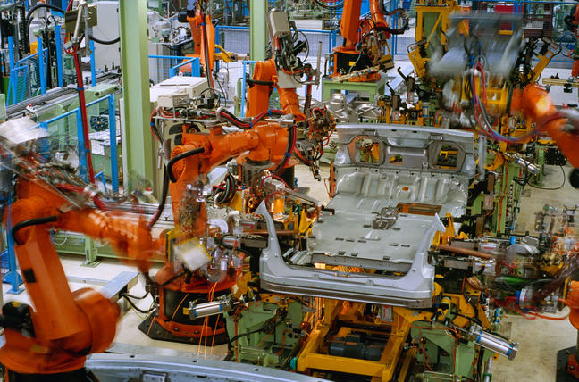 Robots in a car factory.