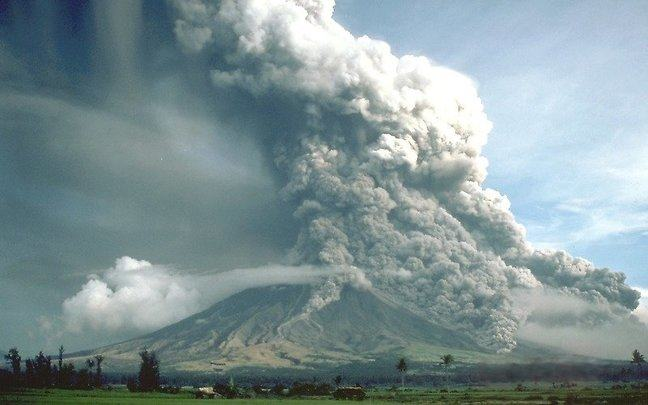 Huge ash cloud billowing out of the Mayon Volcano, Philippines and it subsequent collapse leading to a pyroclastic flow down the sides of the volcano