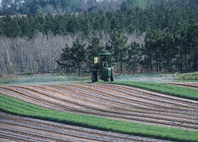 Farming machinery in a crop field