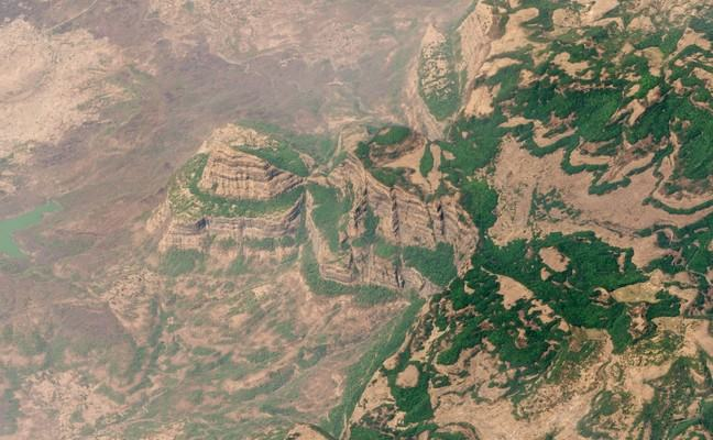 Aerial shot showing the rugged mountains and unusual landscape of the Deccan Traps in Maharashtra, India