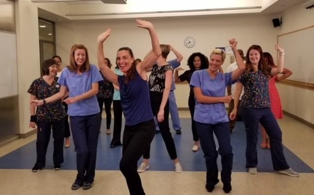 Michelle Bombacie leads NewYork-Presbyterian Hospital nurses in a dance movement class.