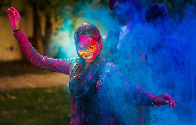 The title image associated with this course, a young woman at a holi festival