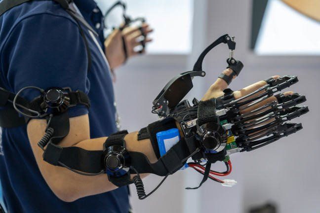 A picture of a person with two exoskeletal hands
