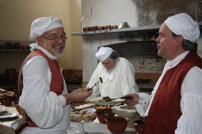 A photograph of a recreation in the Royal Kitchen with 3 cooks