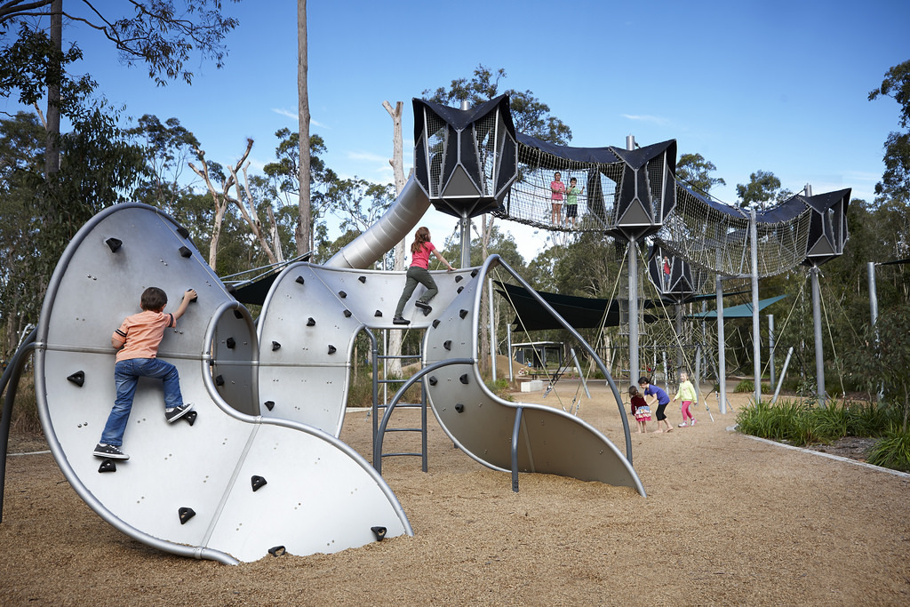 children climbing on play equipment in playground