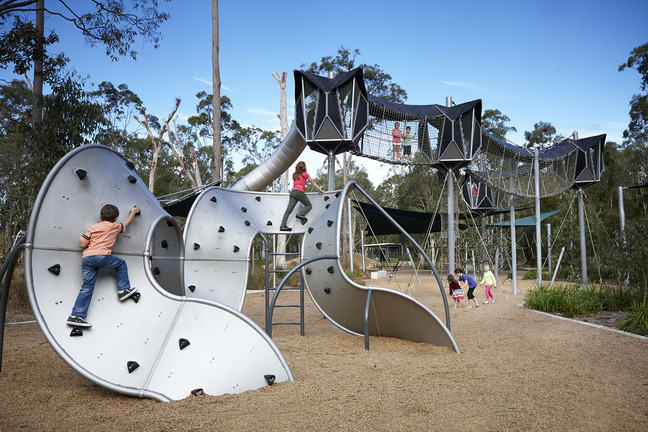 children climbing on play equipment in playground