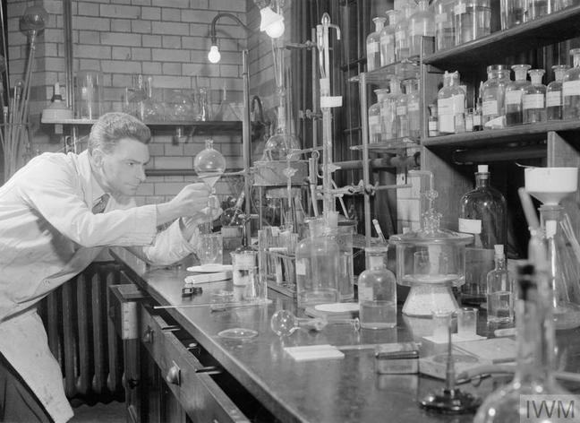 Black and while image of Dr Wilson Baker in his laboratory.