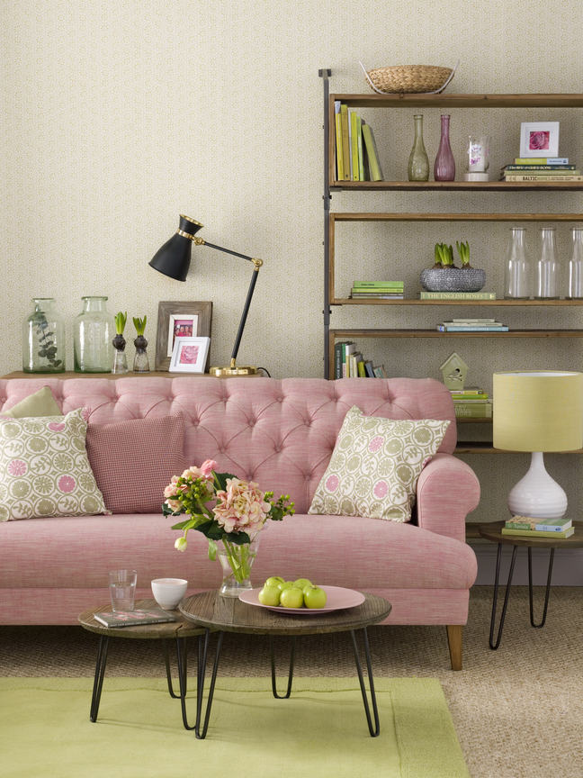 A pink sofa against a neutral background