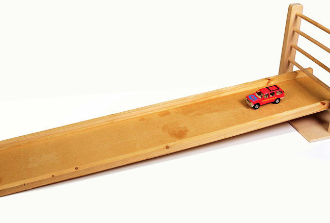 Toy car rolling down a ramp