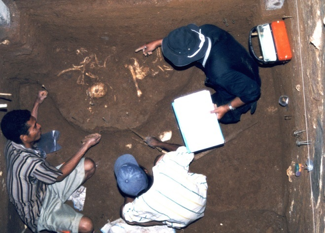 Photograph of the moment when the partial skeleton of Homo floresiensis was unearthed
