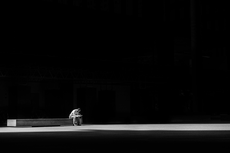 Man sitting on a concrete bench.
